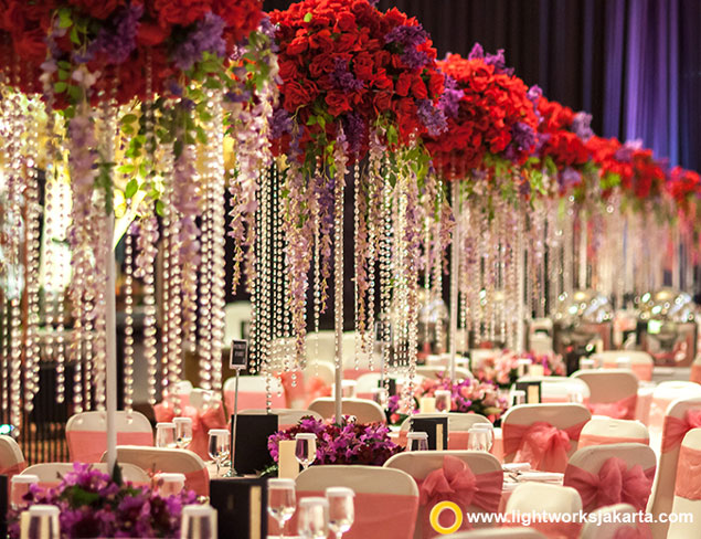 Kharis and Patricia's Wedding Reception | Venue at The Ritz-Carlton Jakarta, Pacific Place | Organised by Eugene Organizer | Photo by Picture House Photography | Gown by Rusly Tjohnardi Atelier | Make Up by Andreas Zhu | Master of Ceremony by Becky Tumewu | Decoration by Steve Decor | Lighting by Lightworks