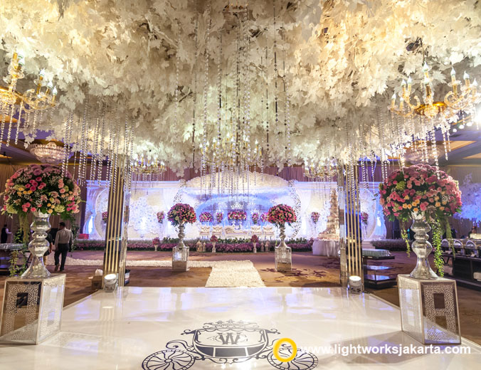 Wahyu and Caroline Wedding's Reception | Venue at Hotel Mulia | Organised by Irene IWP | Photo and Video by Freyja Photography | Decoration by Grasida | Entertaiment by All Star Music | MC by Daddo Parus | Gown by Hiantjen | Tux by Agus Lim | Make Up by W2 Salon Indonesia | Accessories by Rinaldy A. Yunardi | Lighting by Lightworks Jakarta