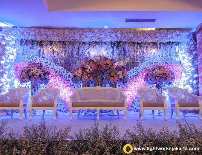 Famiela and Andri's wedding reception | Venue at The Ritz-Carlton Jakarta, Mega Kuningan | Decoration by White Pearl | Lighting by Lightworks