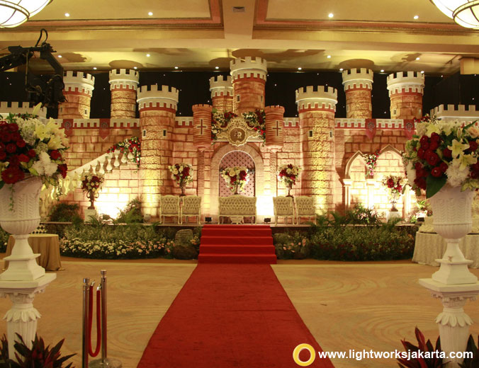 Angga and Roselia's wedding reception | Venue at Balai Samudra | Catering by Alfabeth | Bridal gown by Hiantjen | Make up by Donny Liem | Decoration by Lily Vicky | Photo and video by Maximus | Entertainment by Kana | Wedding cake by LeNovelle Cake | Lighting by Lightworks Jakarta