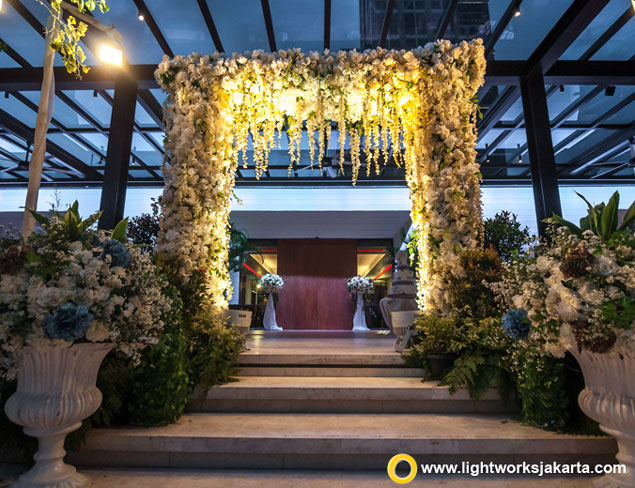 Gerry and Seni's wedding reception | Venue at Grand Hyatt Jakarta | Organised by Eugene Organizer | Decoration by Steve Decor | Music by Wawan Yap | Wedding Cake by LeNovelle Cake | Photobooth by Socialive | Photo and video by Creatopics | Lighting by Lightworks Jakarta