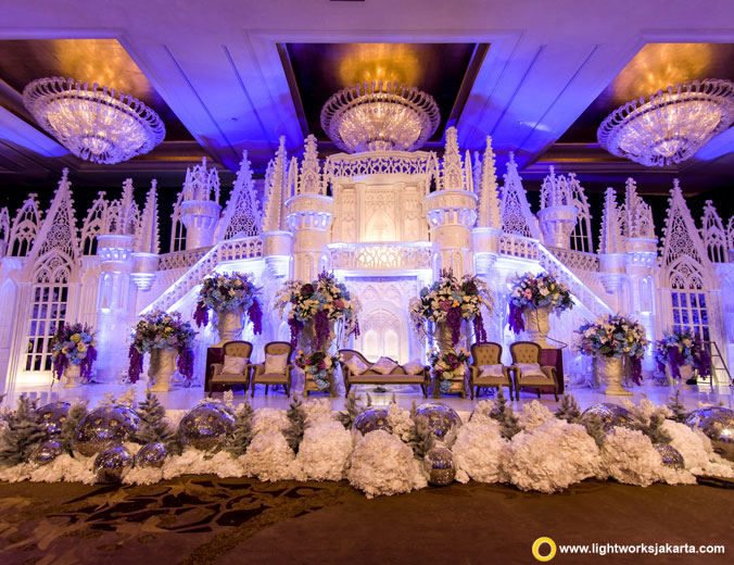 Daniel and Siska's wedding reception | Decoration by Lavender Decoration | Venue at Hotel Mulia | Organised by Divine Wedding Planner | Cake by LeNovelle Cake | Lighting by Lightworks