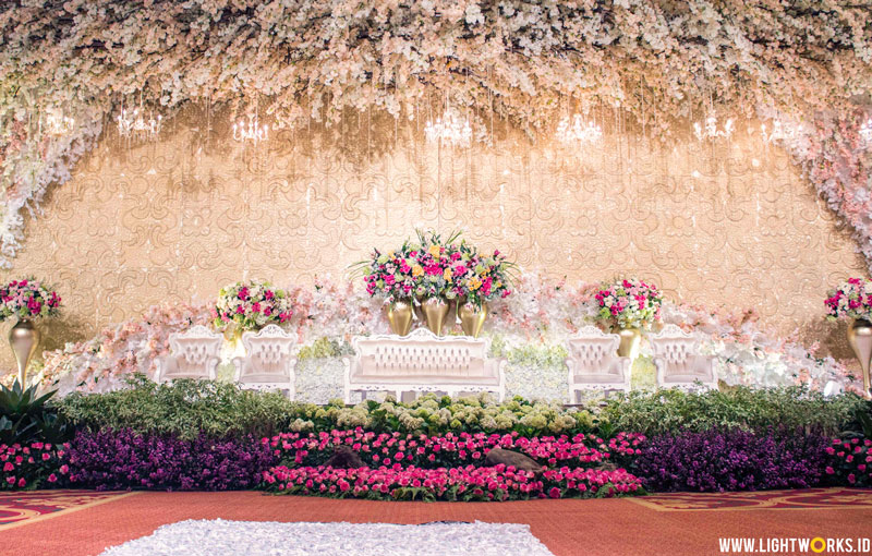 Andrew and Felicia's wedding reception | Venue at The Ritz-Carlton Pacific Place | Decoration by White Pearl Decoration | With William and Friends | Photo by Mono Pictura | Gown by Mr. Yogie Pratama | Lighting by Lightworks