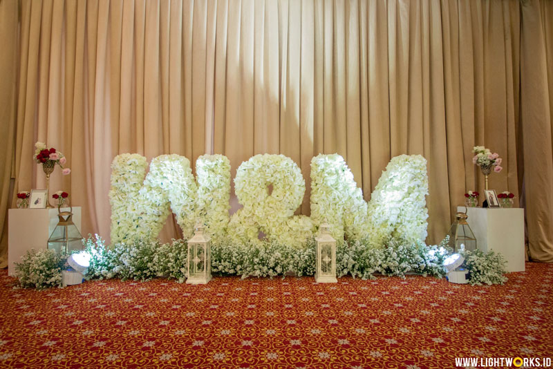 William and Monica's wedding reception | Venue at The Ritz-Carlton Mega Kuningan | Decoration by White Pearl Decoration | Organized by Premiere WO | Entertainment by Red Velvet Entertainment | Photo and video by Kairos Works | Cake by LeNovelle Cake | MUA: ILing Stefanny Make Up Artist | MC: Fanny Kwok | Lighting by Lightworks